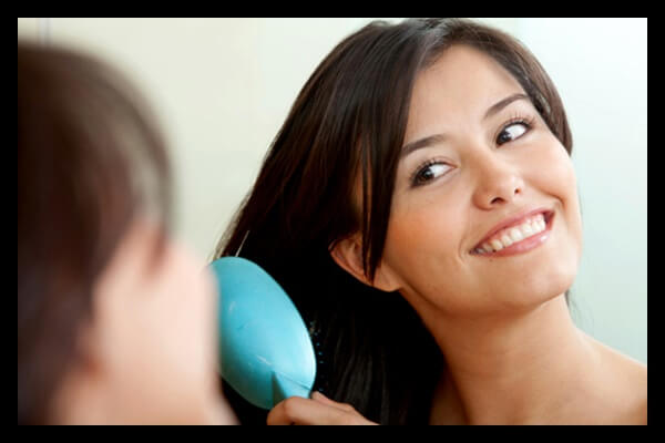 woman-brushing-hair-with-natural-brush1(1)