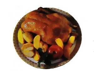 Χριστουγεννιάτικο γεύμα με πάπια με φρούτα και αρωματικά χορταρικά